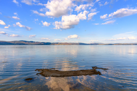 specular: Scenic view of the Lake Trasimeno, Umbria, Italy from the town of Castiglione del Lago