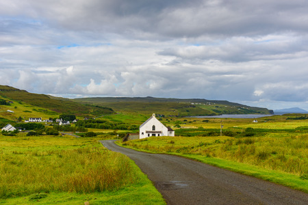 ISLE OF SKYE, SCOTLAND - View of the beautiful nature of the Isle of Skye with a house in foreground near Neist Point.