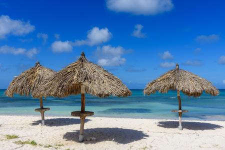Umbrella near the shore on the idyllic Eagle Beach in Aruba