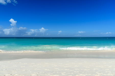 Exotic background with white sand beach and the Caribbean sea. Stock Photo