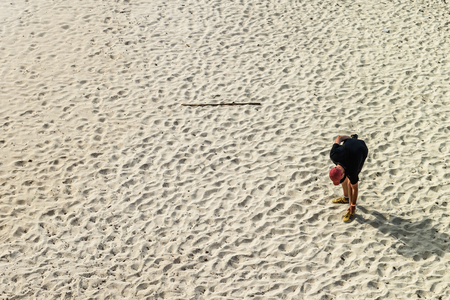 An adult man alone in a beach in the Arikok National Park in Aruba.
