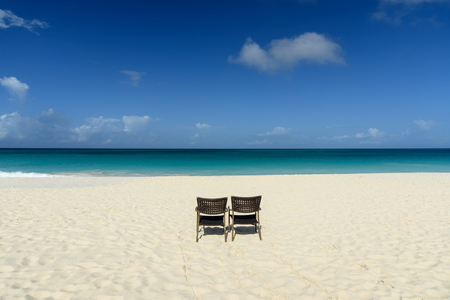 Tropical background with chairs whte sand beach and Caribbean Sea. Stock Photo