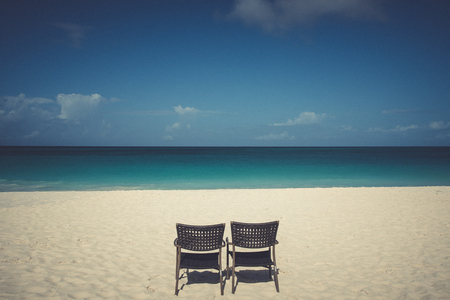 Tropical background with chairs whte sand beach and Caribbean Sea. Stock Photo - 108336127