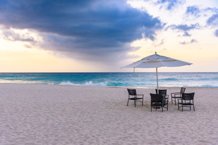 A table ready for dinner in a tranqul and romantic beach of Aruba.