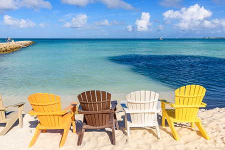 Colorful chairs near the shore of the beautiful Eagle Beach in Aruba