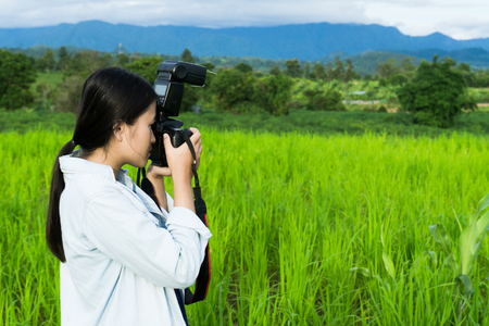 Girl holding camera,Look out to see nature.