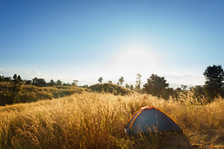 Outdoors camping grass highlands mountain in the Sunset. Stock Photo