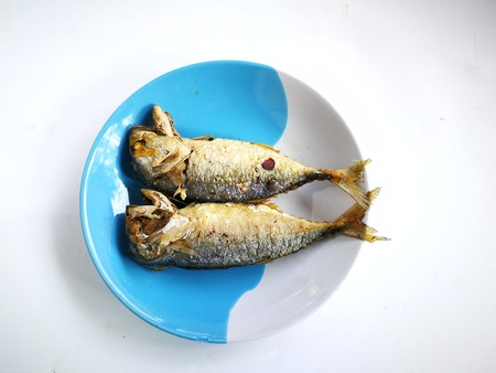 Fried mackerel on the plate. The mackerel fish were cooked by frying. And put them together on a plate.