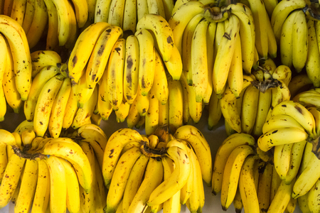 Bananas put together at full floor. Yellow banana with dark spots on the skin. Caused by cooking with gas.