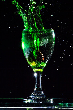 Pour green water into a glass,Water splash in glass. Stock fotó