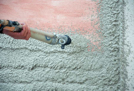 The process of automatically applying plaster (machine for applying plaster) Stock Photo