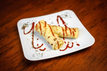 gracefully: Delicious pancakes with meat, spices and sauce on a white plate