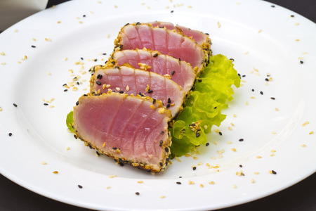ahi: Tuna fillet with sesame on a bi european plate Stock Photo
