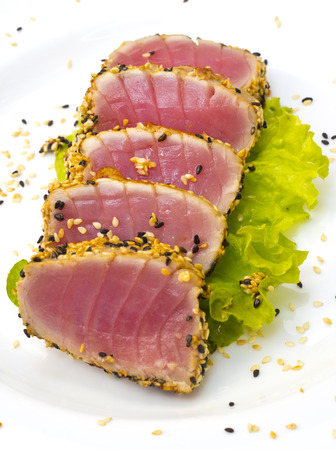 ahi: Tuna fillet with sesame isolated on white