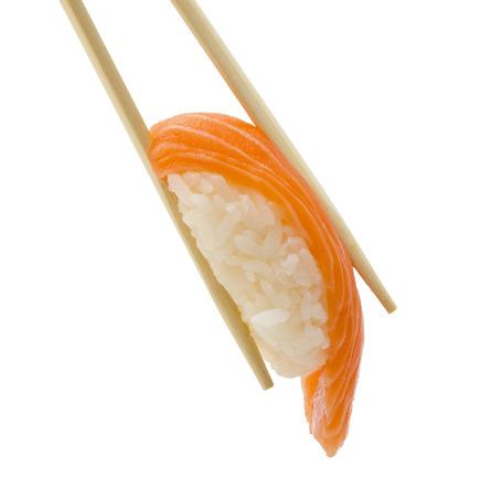 Salmon sushi nigiri in chopsticks isolate on white  Stock Photo