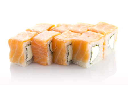 Sushi roll with salmon and cheese isolated on white background. Philadelphia maki.