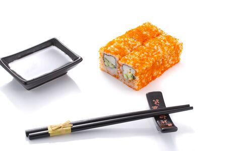 metallic seaweed: Sushi roll with black ceramic plate with soy sauce and black chopsticks isolated Stock Photo