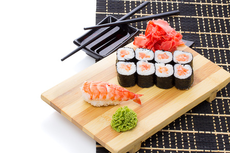 sause: set of japanese sushi with chopsticks and soy sause over white with sample text Stock Photo