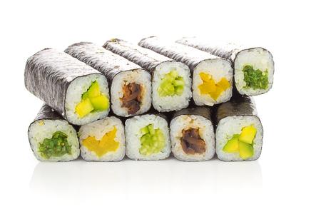 unsliced: Unsliced sushi rolls isolated on white background
