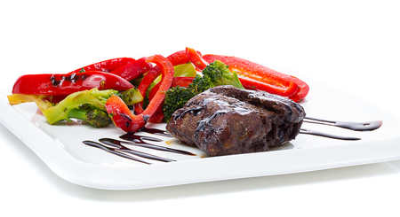 barbequing: A beef stake with steamed green arranged on a white plate
