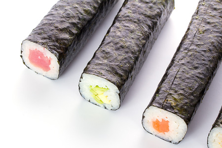 unsliced: Unsliced sushi maki isolated on white background