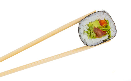 Sushi roll with chopsticks isolated on white