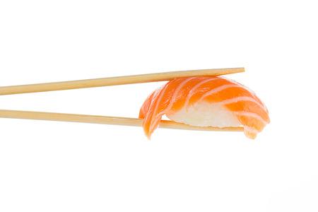 Sushi nigiri with chopsticks isolated on white