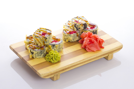 friture: Deep-fried Japanese roll with red caviar avocado and unagi sauce Stock Photo