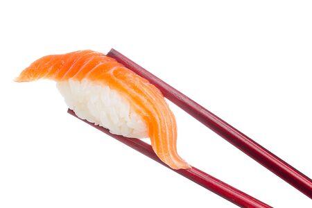 susi: Salmon sushi nigiri in chopsticks isolated on white background