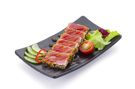 ahi: Tuna filet with sesame and vegetables over white background
