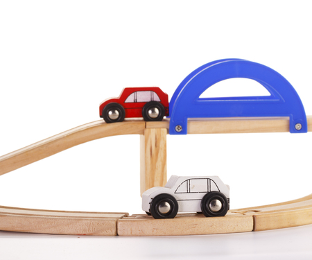 slot car track: A slot wooden cars race set on a track over white background