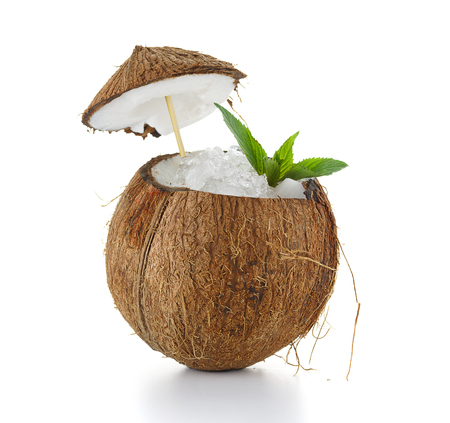 caribbean drink: oconut cocktail with ice isolated on white background