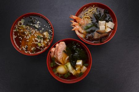 over black: Japanese cuisine.Miso soup set over black background.