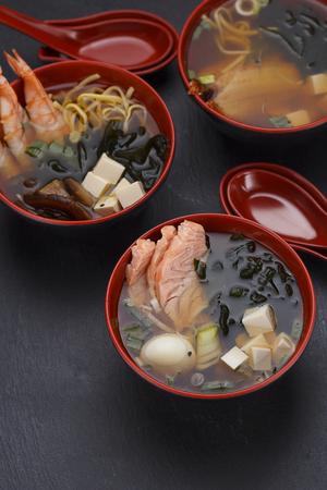 dashi: Japanese cuisine.Miso soup set over black background.