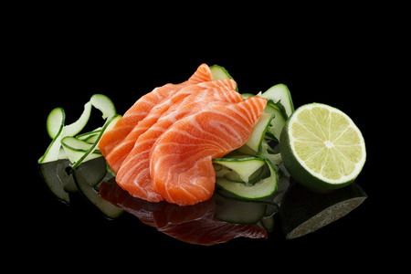 Salmon sashimi over black background 版權商用圖片