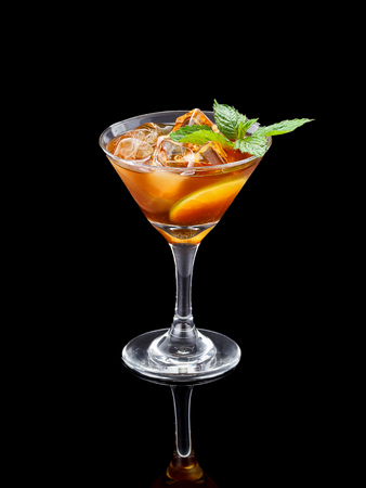 happyhour: Fresh cold alcohol drink over black background Stock Photo
