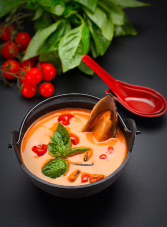 Tasty tomatoe soup with mussel Stock Photo
