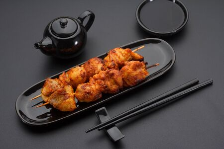 kabab: Chicken skewers on a black plate
