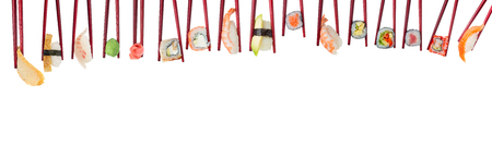 Sushi set in wooden red chopsticks isolated on white background Stock Photo