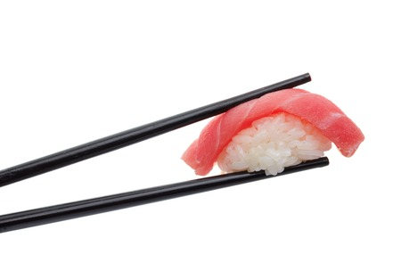Japanese cuisine. Sushi nigiri in chopsticks isolated on white background background.
