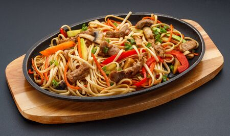 Asian food. Home made noodles with meat and vegetables.