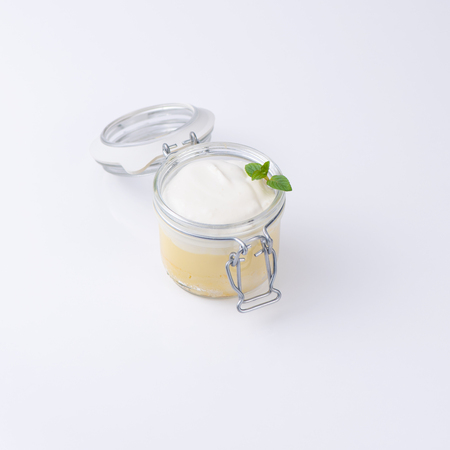 Sweet dessert in a special bottle isolated on white background. Banco de Imagens