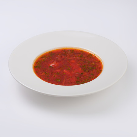 Ukrainian and russian national red borsch isolated on white.