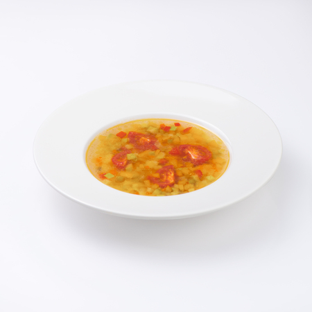 Vegetarian soup with tomatoes. Isolated on white.