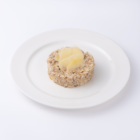 Cooked buckwheat porridge on plate. Isolated on white background,