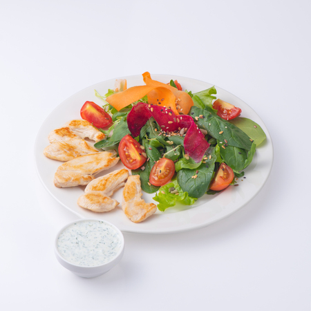 Chicken with salad and sauce. Isolated on white. 版權商用圖片