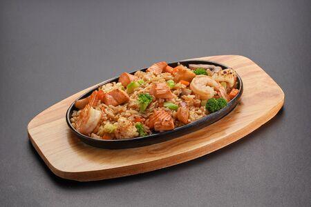Rice with seafood on a black table. Thai dish. 版權商用圖片