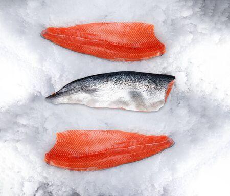Fresh raw salmon fillet on ice