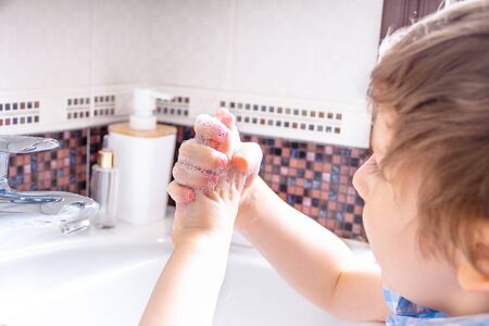 Cute Little kid boy Wash hands with soap. Clean and Hygiene concept. Archivio Fotografico