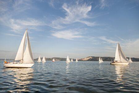 White sailing yacht before starting regatta